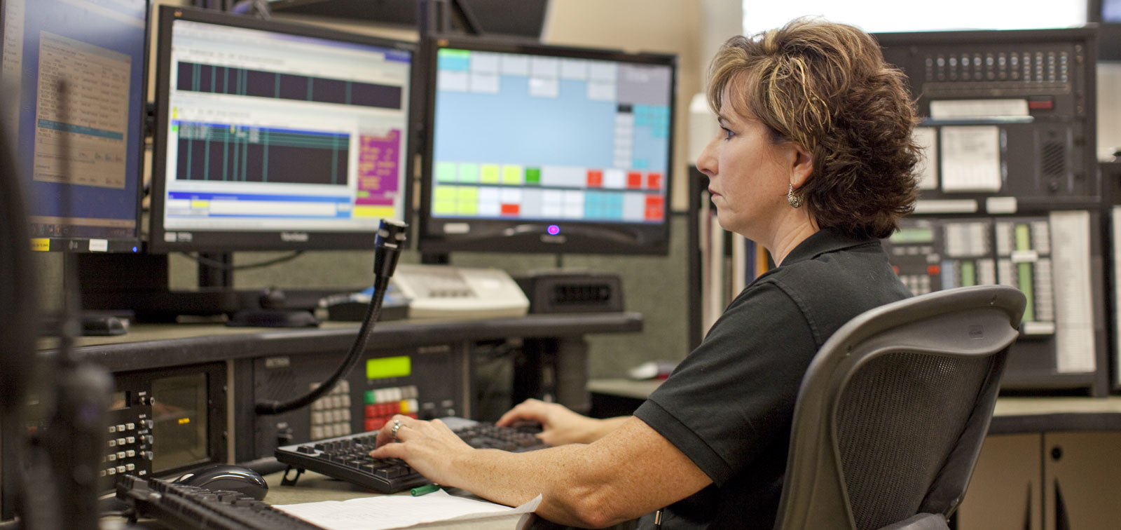 Woman working at utility command station